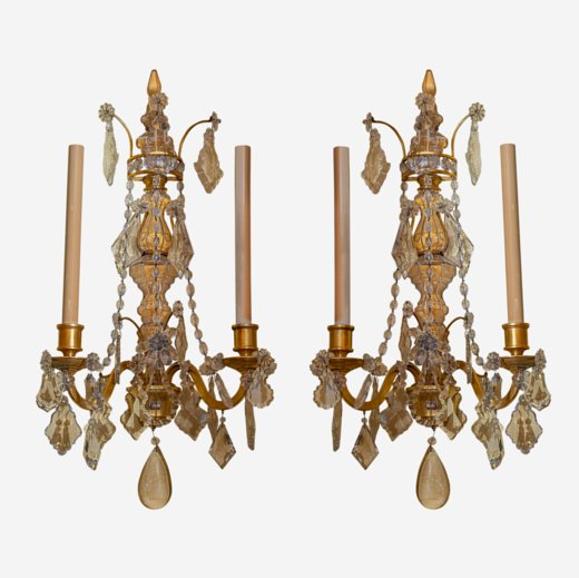 Pair of crystal and bronze 2-light wall lights.  Attributed to Bagues