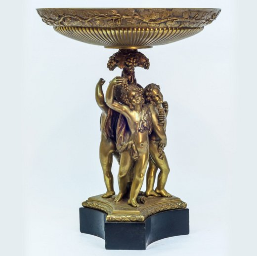 A gilt bronze neoclassical figural centerpiece on black marble base