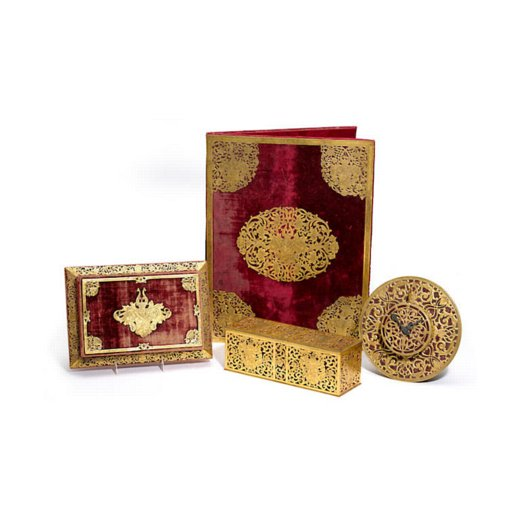 An American gilt bronze mounted red velvet four piece desk set by Caldwell
