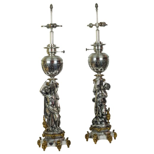 A Fine Pair of Silvered and Gilt Bronze Figural Cherub Lamps