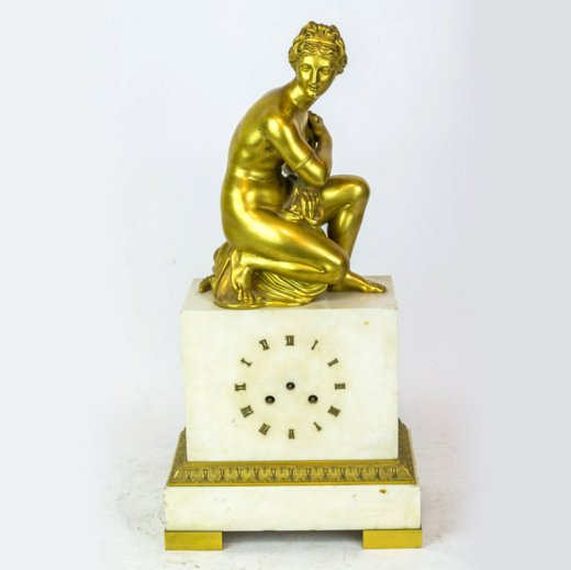 A Gilt Bronze and White Marble Classical Figural Mantel Clock