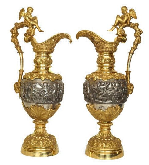 Massive Pair of Gold and Silvered Bronze Figural Pitchers with Cherubs Signed